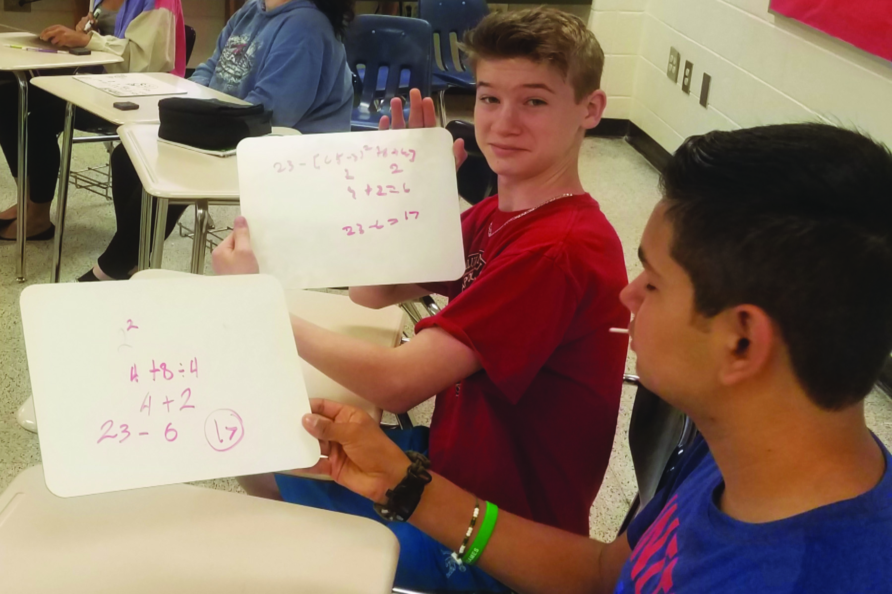 Creekview High School rising freshmen Toby Kennedy and Jesus Adrian Duarte-Armas participate in a math class as part of the school's 'summer bridge' program.