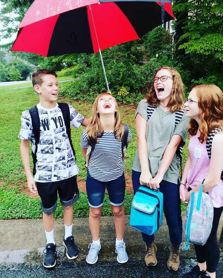 Mill Creek Middle School students do their best to tell the rain to stay away from #CCSD1stDay: from left to right, seventh-grader Colin Giles, sixth-grader Kendall Giles and eighth-graders Zoe Gagnon and Sophie Croker.
