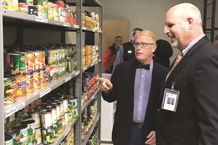 Superintendent of Schools Dr. Brian V. Hightower, left, and Cherokee HS Principal Todd Miller tour the food pantry, which will serve the school's families in need.