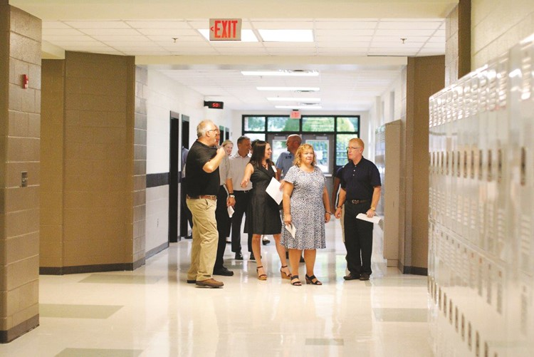 Facility Construction Lead Supervisor Steve Werner, left, leads a tour of Cherokee North for Superintendent of Schools Dr. Brian V. Hightower, right; School Board members including Chair Kyla Cromer, center; and Kelly Poole, left; and senior staff.  In this image, you can see the new interior painting to match the main campus and the newly installed lockers.