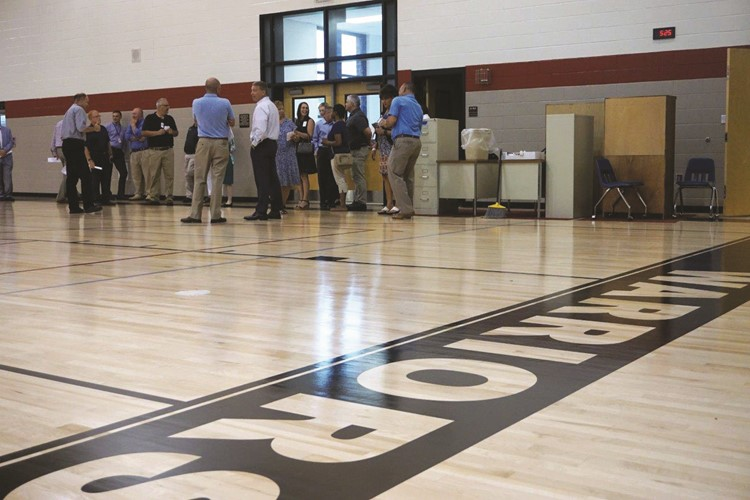 The gym was repainted and the floor refinished to match the Cherokee HS main campus.