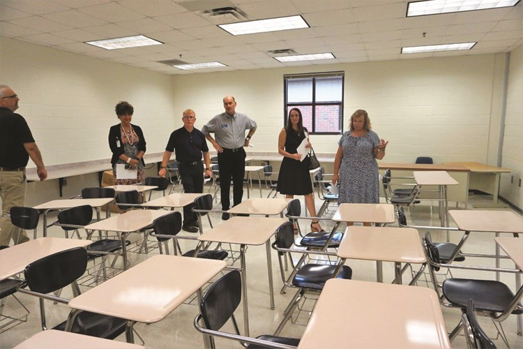 School Board members, from left to right, Patsy Jordan, Vice Chair Mike Chapman, Superintendent of Schools Dr. Brian Hightower, Kelly Poole and Chair Kyla Cromer review a classroom in Cherokee North.  Appropriately sized furnishings and fixtures are now in place, as is new classroom technology.