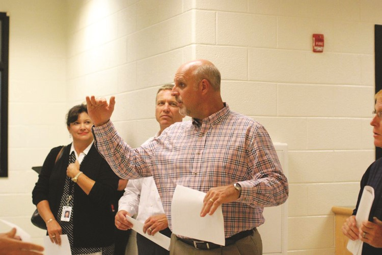 Cherokee HS Principal Todd Miller explains how the former media center at what is now Cherokee North will serve the high school's growing band program.