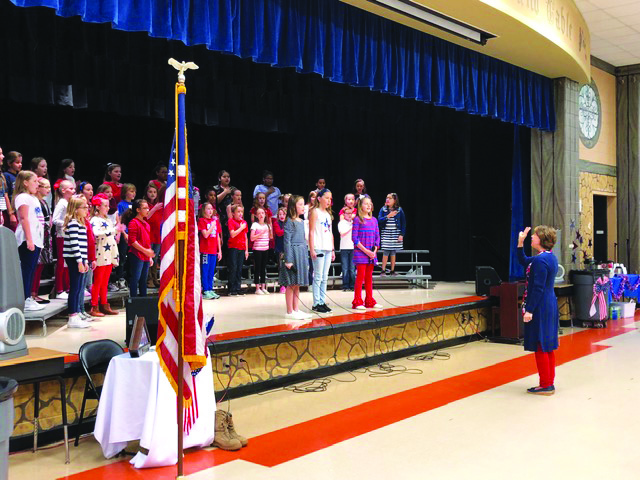 Knox ES students sing patriotic music for their veterans.