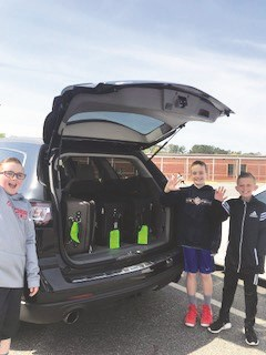 Liberty ES fourth-graders, from left to right, Jacob Duncan, Blake Spivey and Jaxon Pfanstiel, load donations up for Tony Endozo, husband of fourth-grade teacher Michelle Endozo, to bring with him to Puerto Rico while there for business.