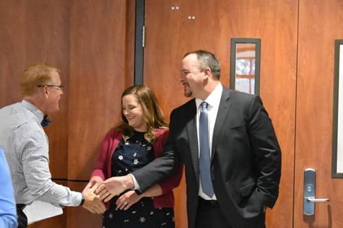 Superintendent of Schools Dr. Brian V. Hightower shakes hands with new R.M. Moore ES Assistant Principal Adam Parker and his wife, Neely, who teaches at Indian Knoll ES.