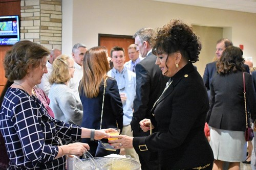 School Board member Patsy Jordan, right, enjoys the punch made by CCSD School Nutrition staff including Cassandra Higgins.