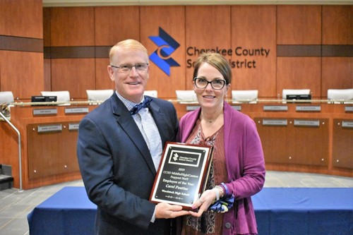 Superintendent of Schools Dr. Brian V. Hightower congratulates Woodstock High School Principal's secretary Carol Pontius as CCSD Support Staff Employee of the Year from all high schools/middle schools/centers.