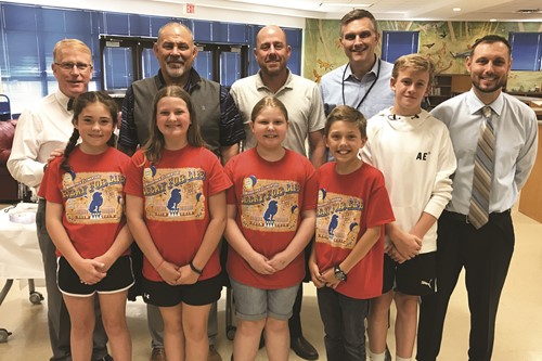 Woodstock ES students and Principal Matt Freedman, right, welcome, from left to right, Superintendent of Schools Dr. Brian V. Hightower, School Board members Rick Steiner and John Harmon, and CCSD Deputy Superintendent Trey Olson.