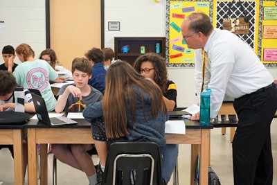 researcher talks about ideas in a classroom with students