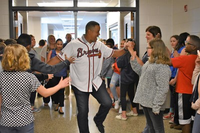 students greet brian jordan