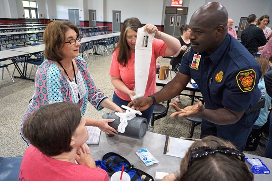 paramedic instructs teachers in medical training