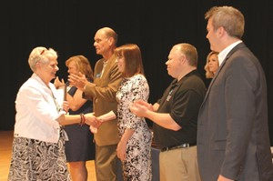 Liberty Hill Church, partner of Hasty Elementary School Fine Arts Academy, is the CCSD 2017 Partner of the Year. Church member Teresa Abernathy is congratulated by School Board Member Kelly Poole, as other school board members look on.