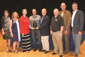The CCSD 2017 Volunteer of the Year, Scott Cudabac of Johnston Elementary School, center, is congratulated by, from left to right, School Board Member Kelly Poole, School Board Chair Kyla Cromer, Principal Amy Graham, Superintendent of Schools Dr. Brian V. Hightower, School Board Member Clark Menard, School Board Vice Chair Mike Chapman and Kevin Williams, Fundraising Chairman for the Cherokee County Educational Foundation, which sponsors the awards ceremony and reception.