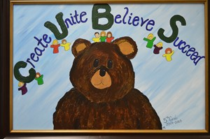 photo of a painting that says Create Unite Believe Succeed