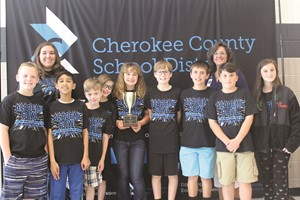 Arnold Mill ES team members and coaches celebrating their second-place win are, from left to right, front row: Cullen Moore, Aijaz Syed, Nate Griesbeck, Drew Gintert, Dellaina McCarty, Caden Banks, Kaiden Smith, Mitchell Gallion, and Sarah Conkle; back row: Coach Christina Dowdy and Assistant Principal Dr. Christy Bowling