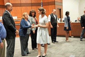 student shakes hands with school board members during recognition