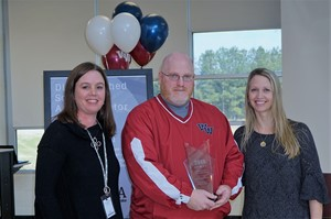 photo of Mark Smith with Media Specialists Kimberly George, left, and Jennifer Cogdill, right.