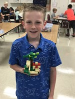 Student holds up a lego creation