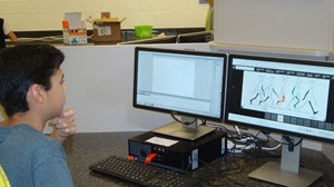 Photo of 8th grade ET Booth student working to refine his animation of a walk cycle.