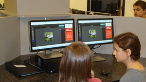 Photo of 6th Grade E.T. Booth students checking out digital photography editing software.