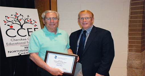 Photo of Volunteer of the Year, Toby Skylar, and CCSD Superintendent Dr. Brian Hightower
